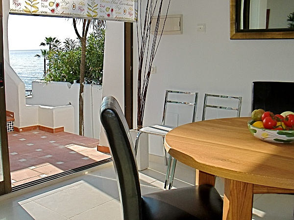 A view to the sea from the dining table. The apartment features full A/C.