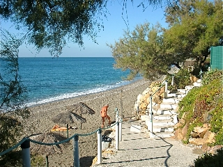 Costa-Natura Beach. Picture taken in the morning, when the Naturist Holiday Resort is not yet very active.